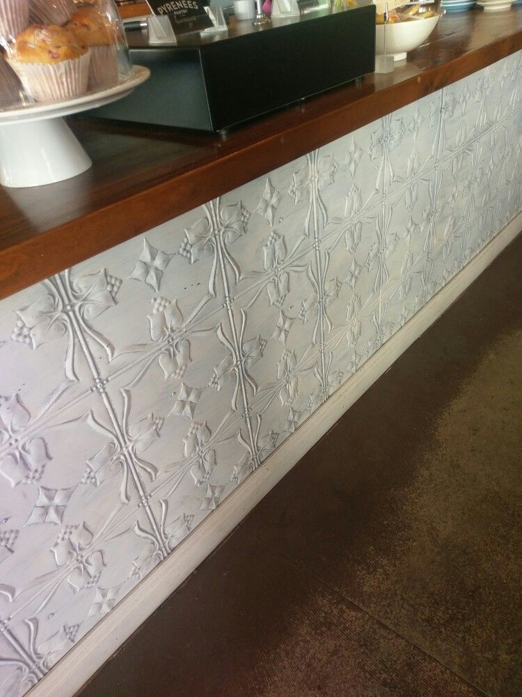 Pressed tin under wooden bench