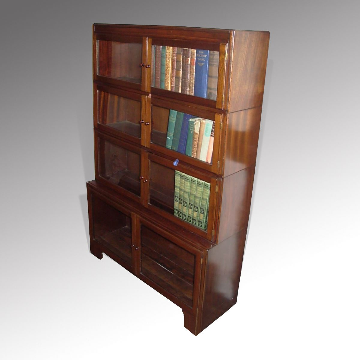 Vintage glazed bookcase by 'Minty'.  These were very popular in the 1930's Four separate interlocking sections make it very easy for moving.