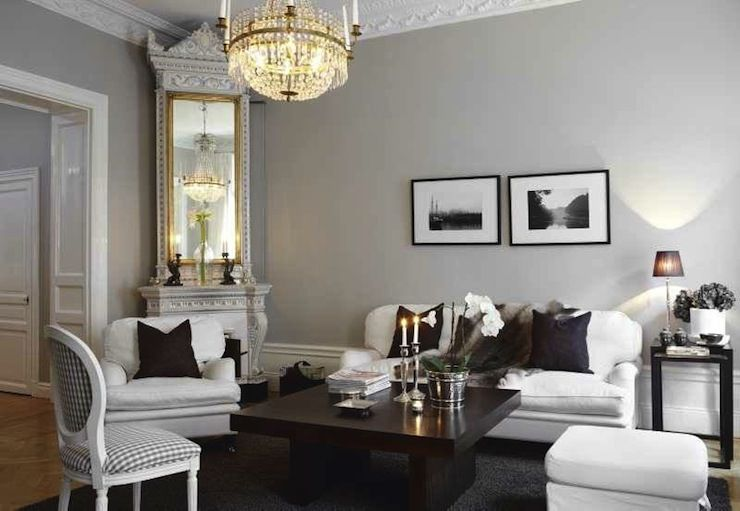 Chic Swedish Living Room With Gray Walls Accented Crown Molding Corner Fireplace