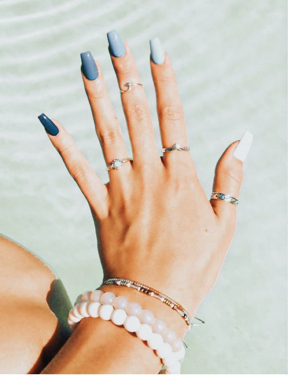 Sweet grey and white manicure with many accessories