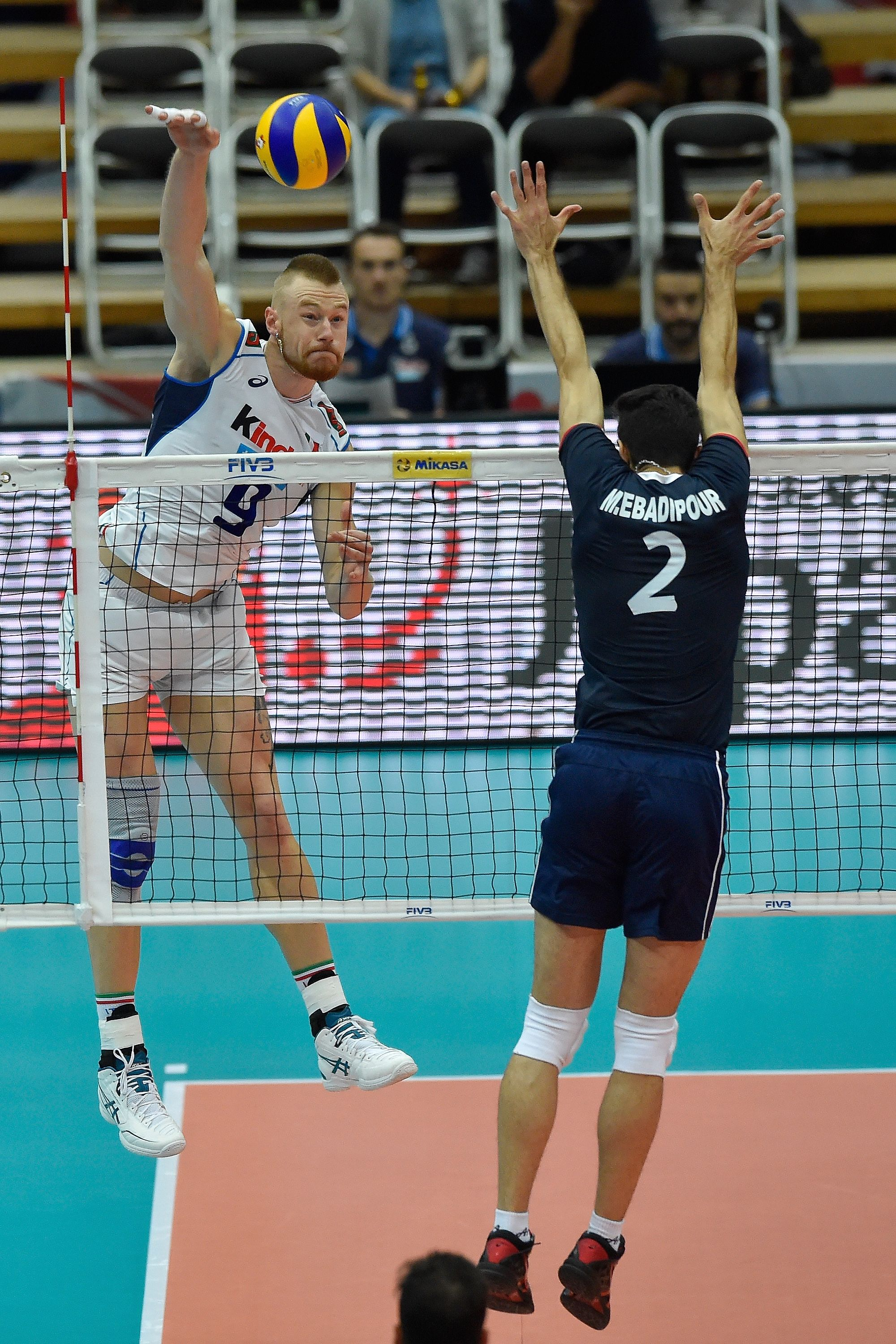 Ivan Zaytsev Spikes The Ball Against Iran S Block Volleyball Photography Mens World Cup Beach Volleyball