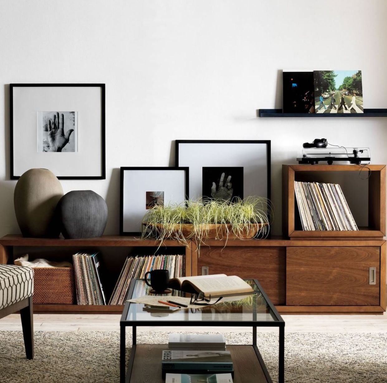 Designed by william eastburn the aspect walnut sliding door storage unit is a crate and barrel exclusive