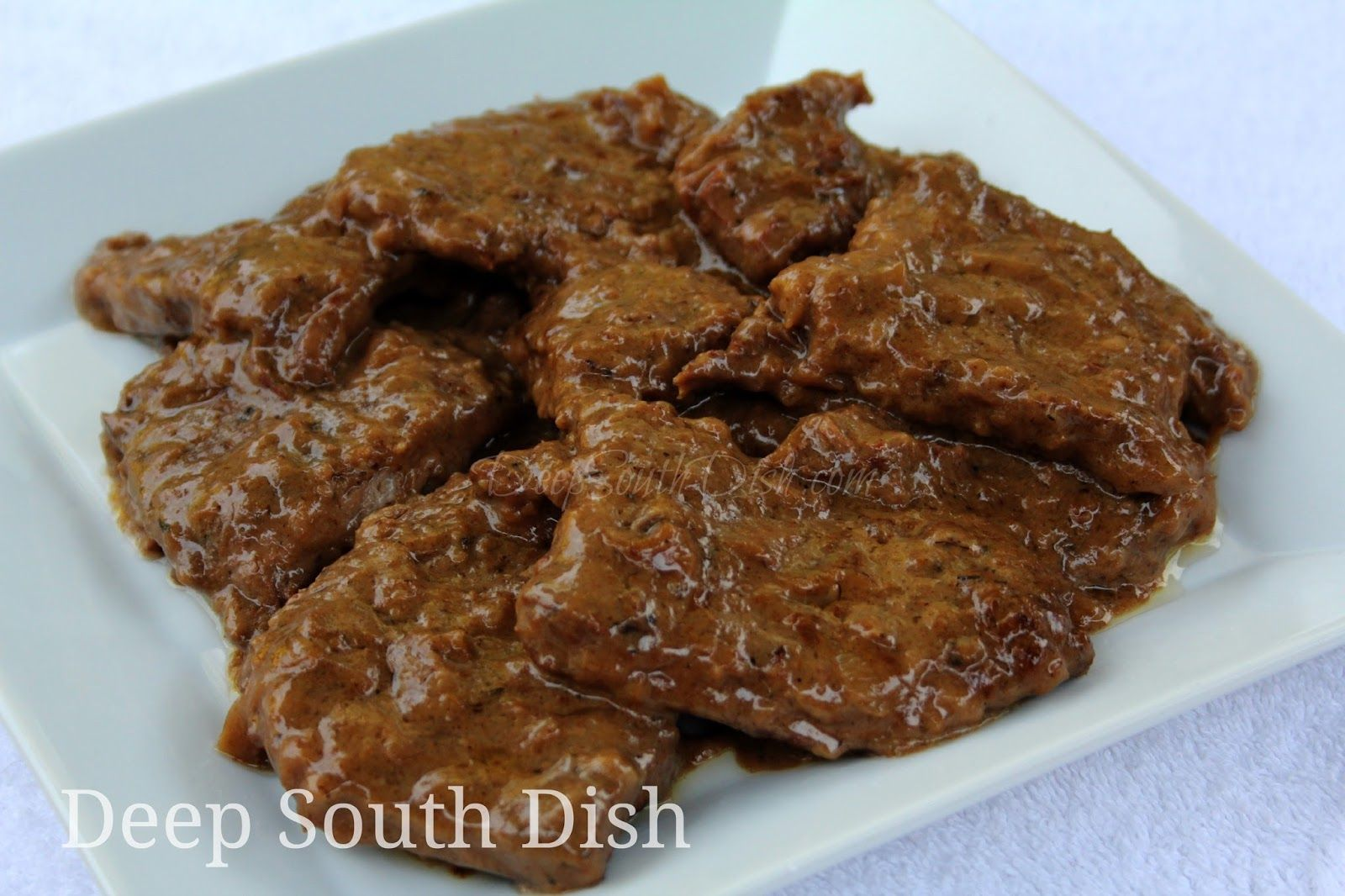Steak And Gravy With Onion Poor Man Steak Made With Bottom Round Steak And Slow Simmered In A