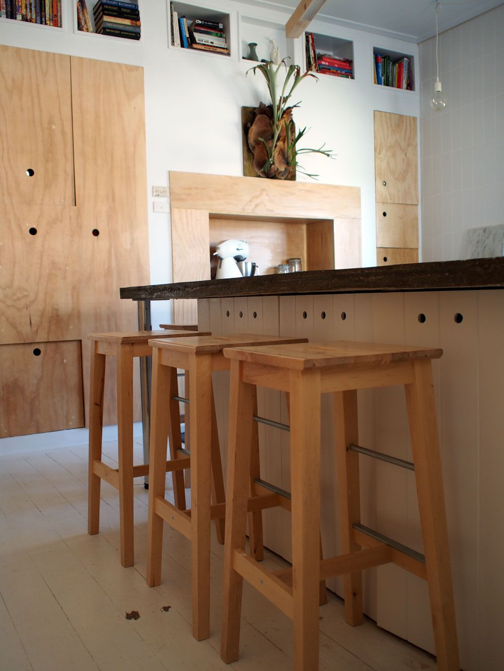 White, plywood kitchen with concrete countertops Plywood