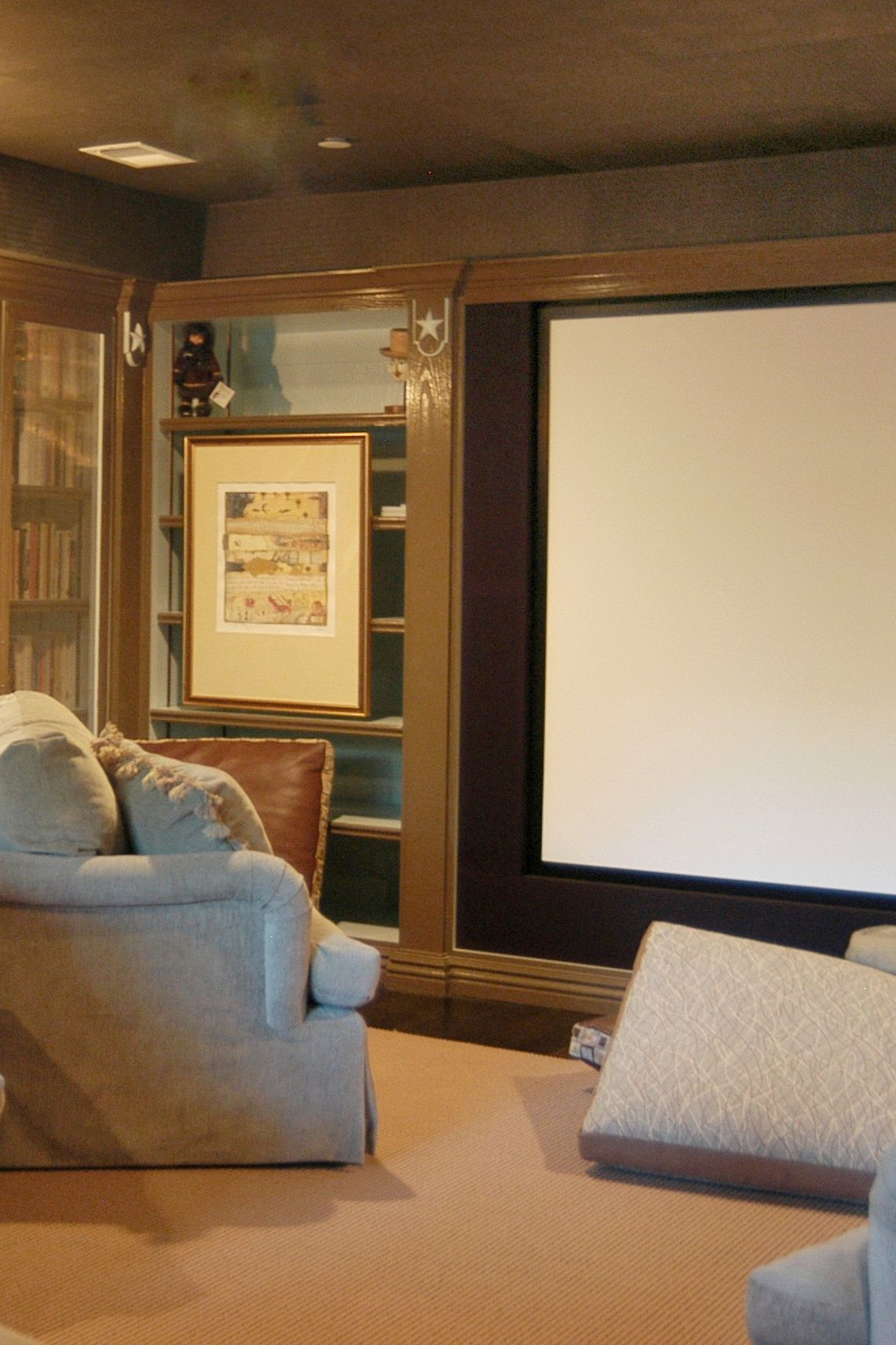 Luxury Home Theatre Design With Library Feel And Large Screen And