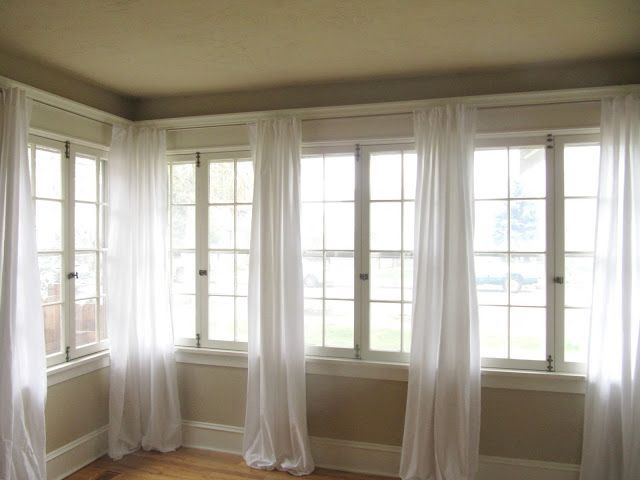 cheaper than fabric all you have to do is split and cut along already hemmed edge to hang on curtain rod