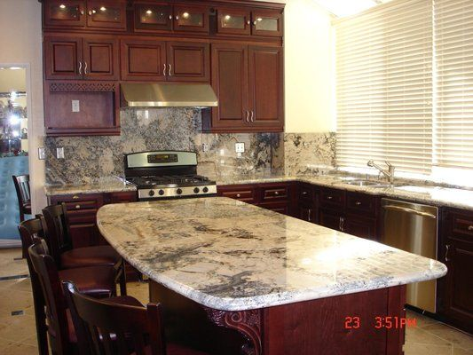 White Kitchen Black Hardware Marble Backsplash