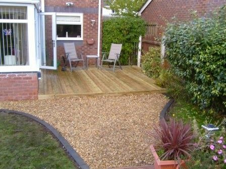 Deck and pea gravel outdoor garage ideas decking - Exterior concrete leveling products ...