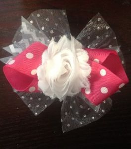 DIY Flower Hair Bow.  Super easy and inexpensive!  I could make one to go with every outfit!  from www.mommyandmadelyn.com