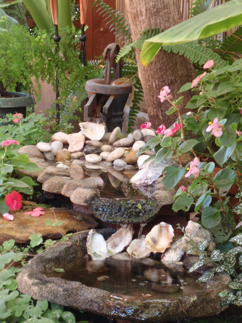 Old water pump incorporated into water feature