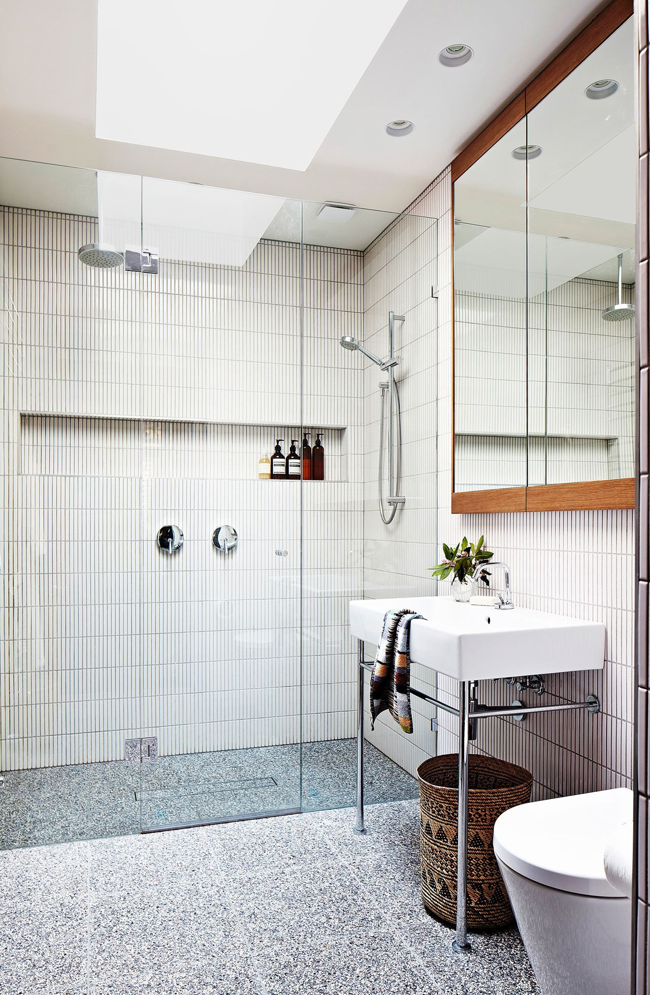 A luxurious double shower and console-style basin help make the most ...