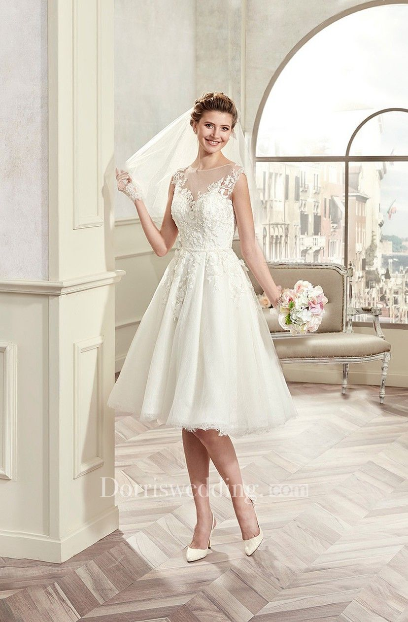 Capsleeve kneelength wedding gown with illusive design and lace