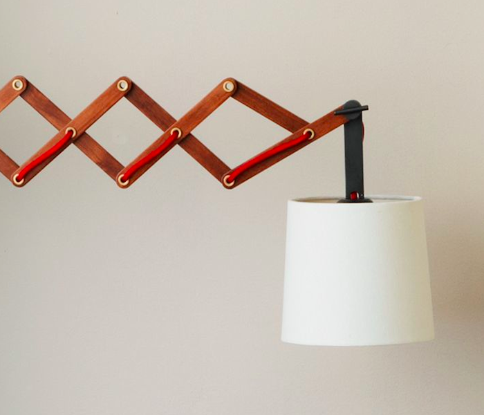 Bedside lighting. Wood Accordion Light from West Elm | Remodelista - Current Obsessions: May Day Woods, Lights And Alcove