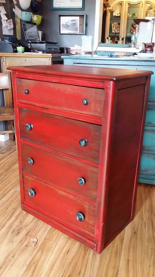 simple distressed red dresser with black and turquoise graduated