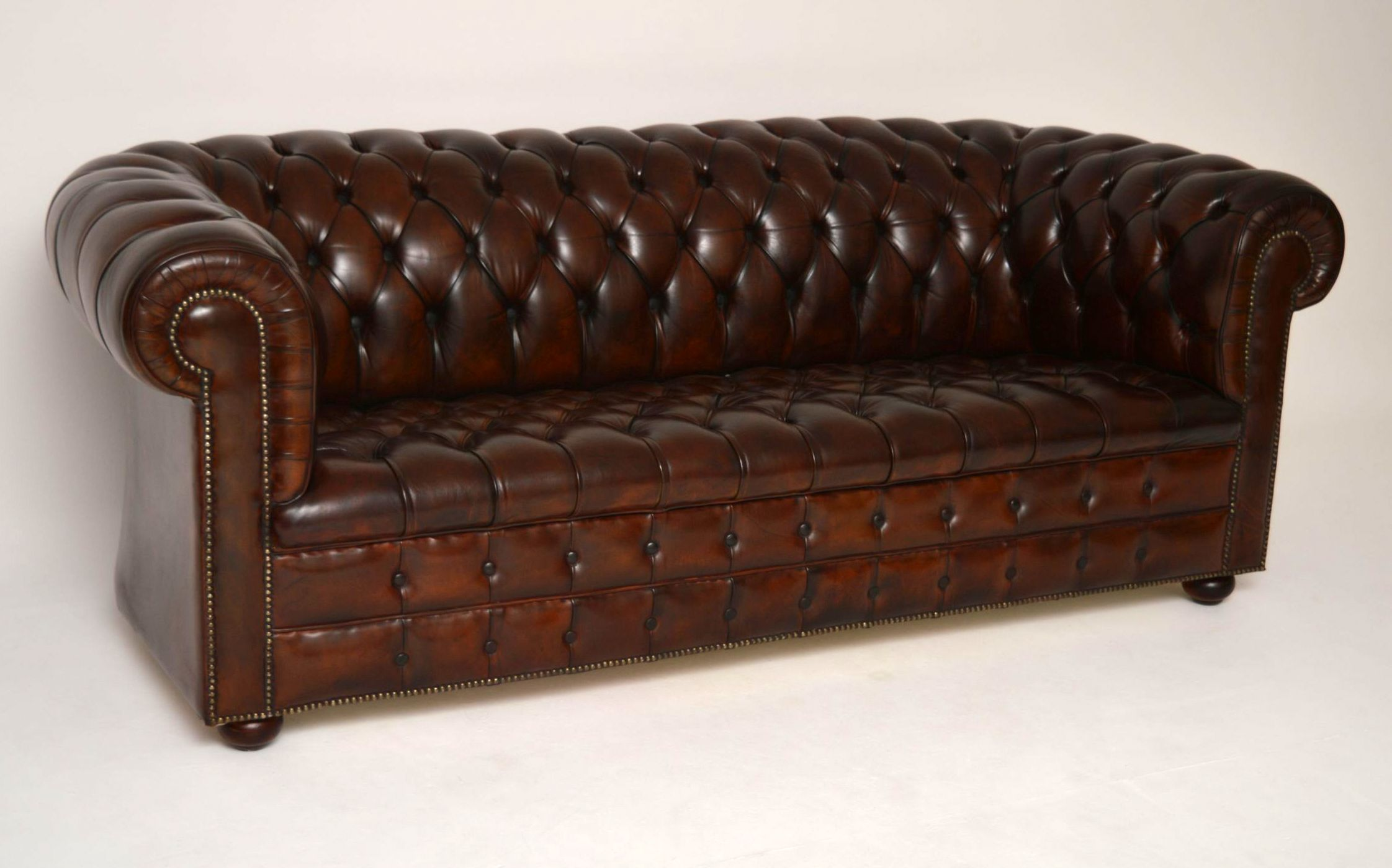 This antique deep buttoned leather Chesterfield is very smart