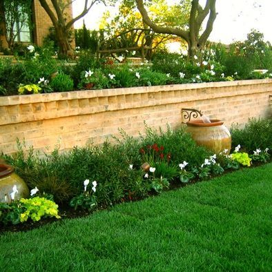 I love the water feature on the wall. Landscape Retaining Wall ...