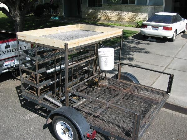 Utility Trailer by Ken Reed -- Homemade utility trailer constructed from a commercial flatbed trailer, angle iron, wire mesh, and lumber. http://www.homemadetools.net/homemade-utility-trailer-3