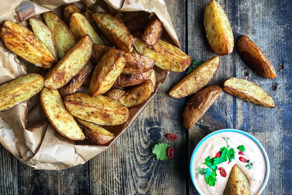 Recipe for sweet paprika and cumin roasted potatoes with harissa mayo in english at the bottom....