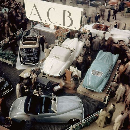 Luxury section of the Paris Auto Show Salon with A.C.B. Bodies (Atelier de Carrosserie de Becon). In the foreground is a 11 HP Citroen chassis with A.C.B. body and the three cars behind are peacock blue and grey Talbot, and a yellow Delahaye, Paris, France 1948. Photo by Yale Joel—The LIFE Picture Collection