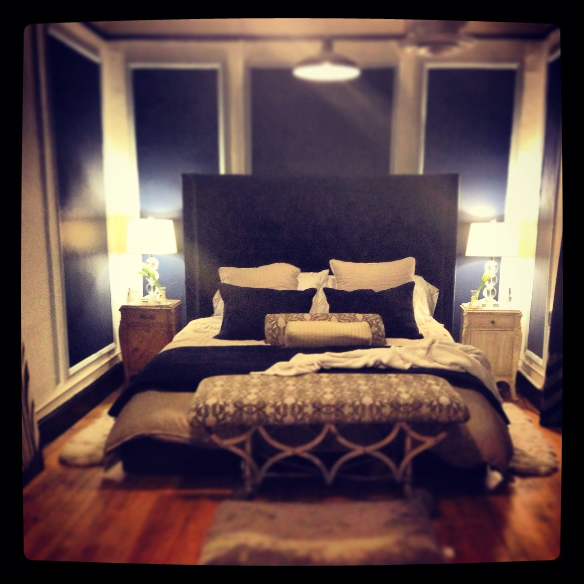 Master Bedroom With A City View Navy Blue White And Tan