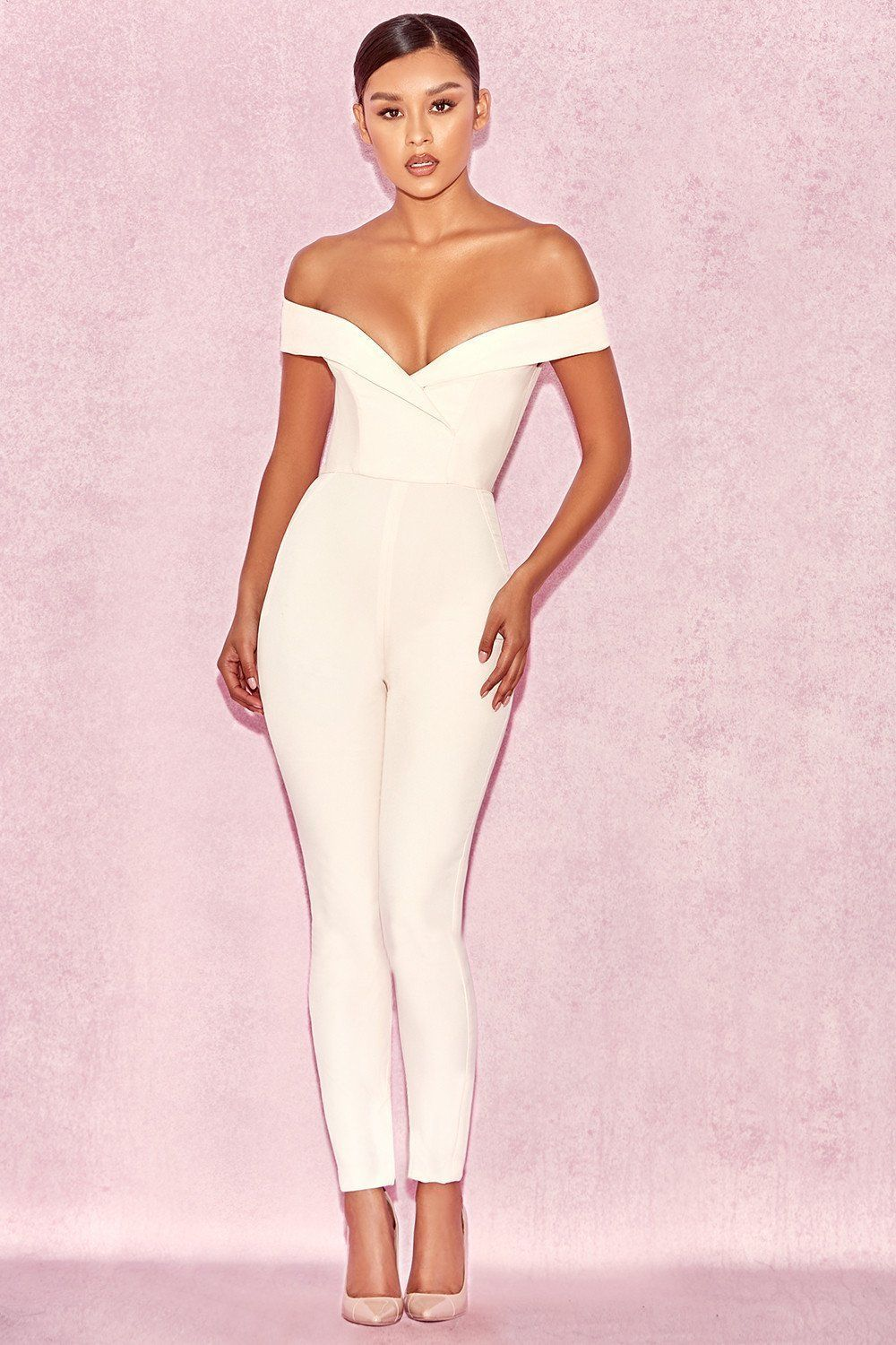 fabeaf2fa120 Your curves deserve this ultra elegant white jumpsuit. Featuring an off the  shoulder bust