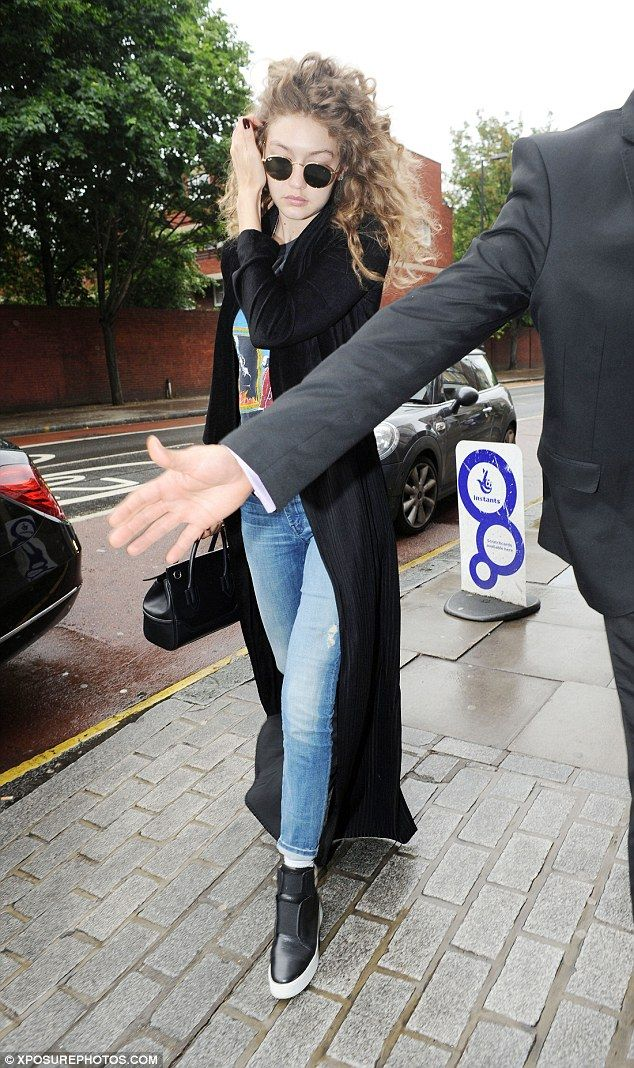 Curly girl:Gigi Hadid maintained a steely face in light of his critics as she stepped out...
