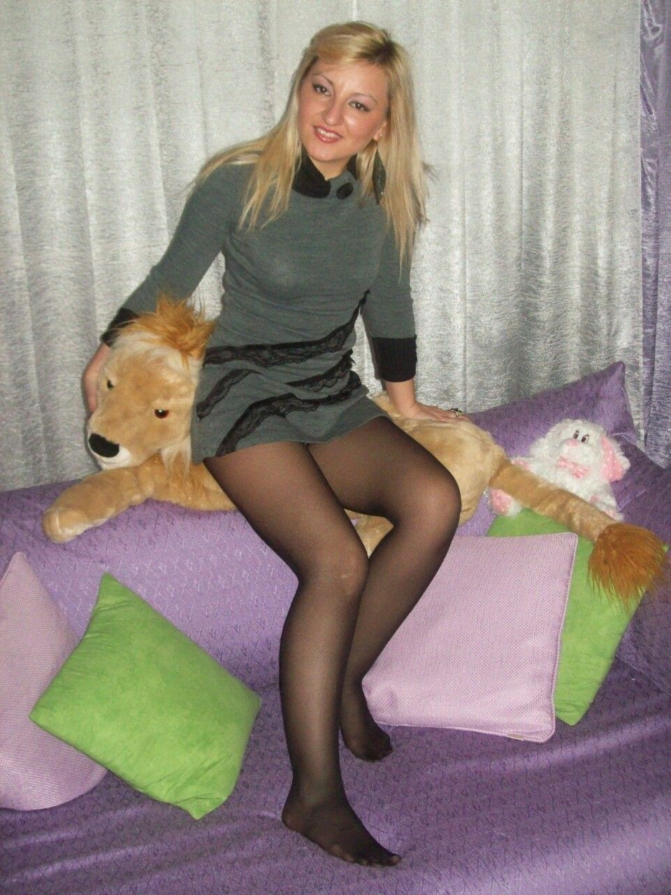 hot wife in knitted dress and black pantyhose without shoes. woman