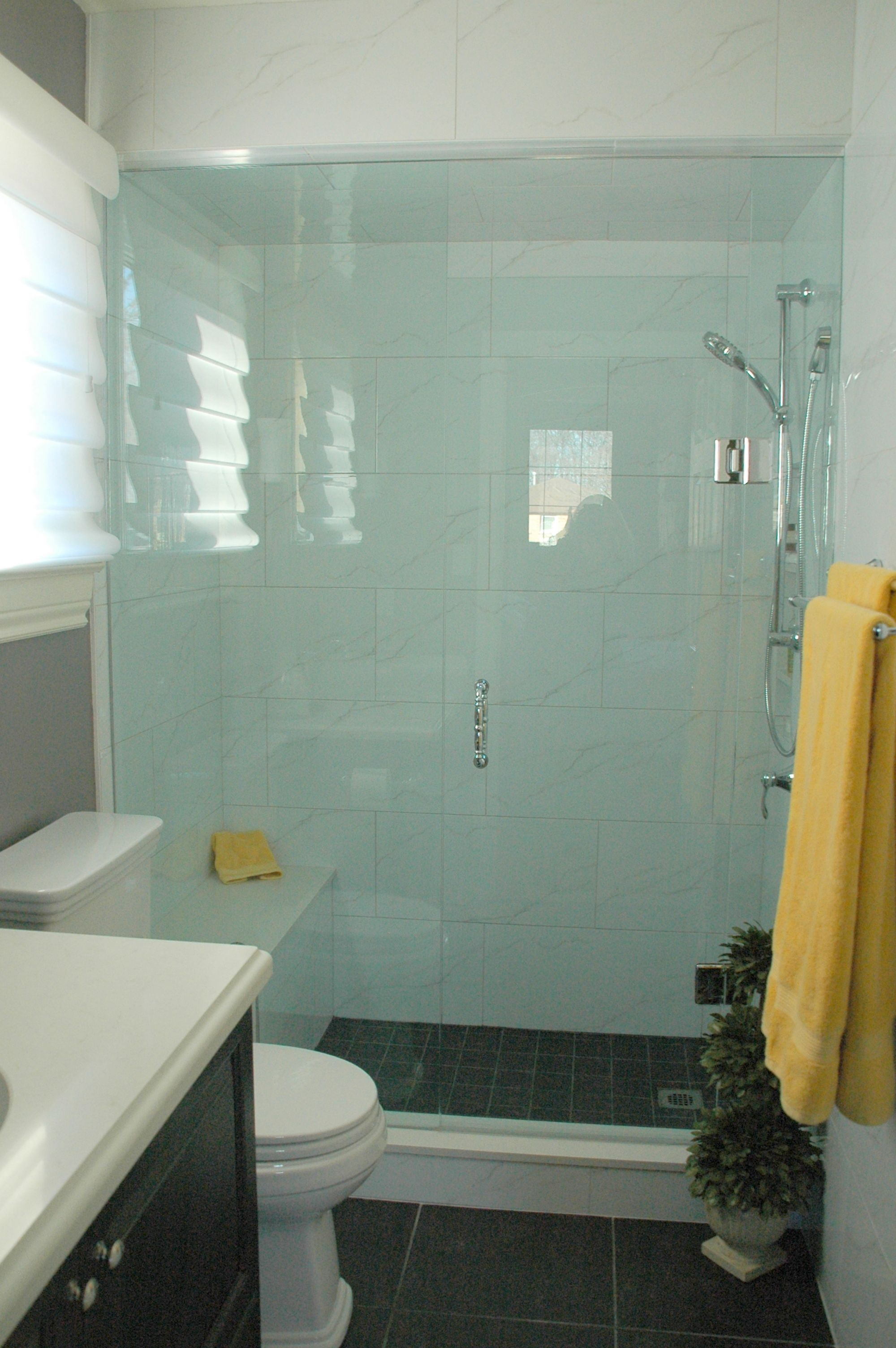 Custom glass shower enclosure with seat. Porcelain tiles 12x24 ...