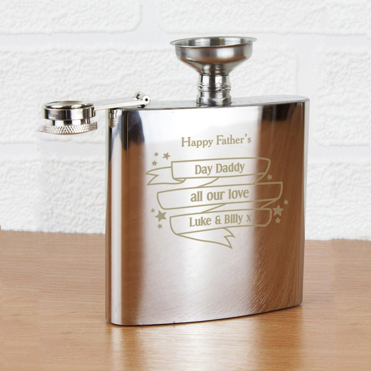 Personalise this Shining Star hip flask with any message over 4 lines and up to 15 characters per line. Including spaces and punctuation.  Personalisation will appear as entered, if you require it to be in UPPER CASE, please enter in this style.  Steel is the material for an 11th Wedding Anniversary and this Hipflask would make the perfect gift!  This Hip Flask comes presented in a gift box.  The material of this product is stainless steel.