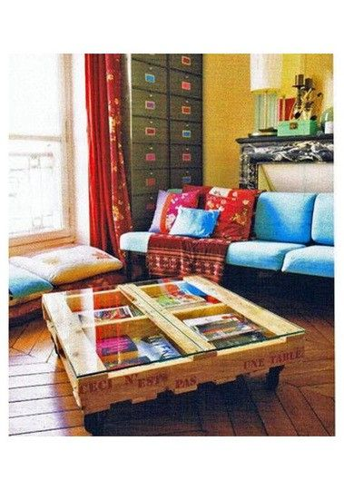 Adorable coffee table out of pallets. Love the whole room too, so colorful and inviting.