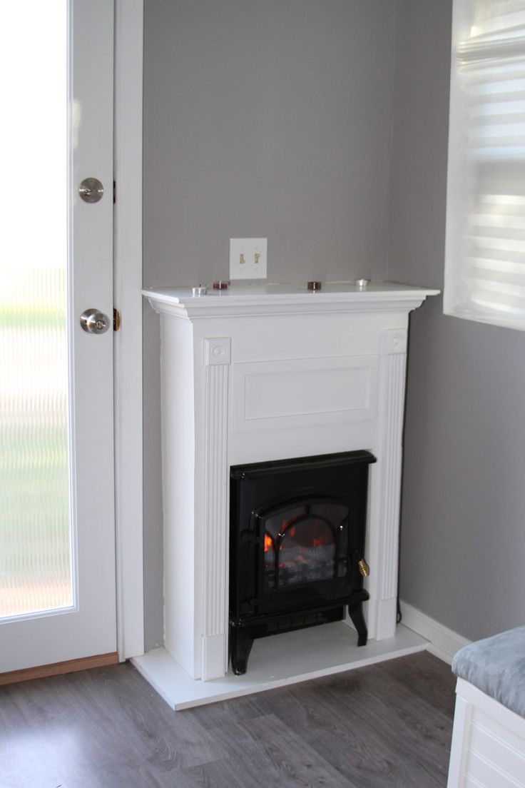 Image result for faux fireplace around a heater Basement Ideas