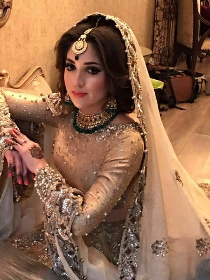 Golden Dress With Bits Of Green In Jewellery Pakistani