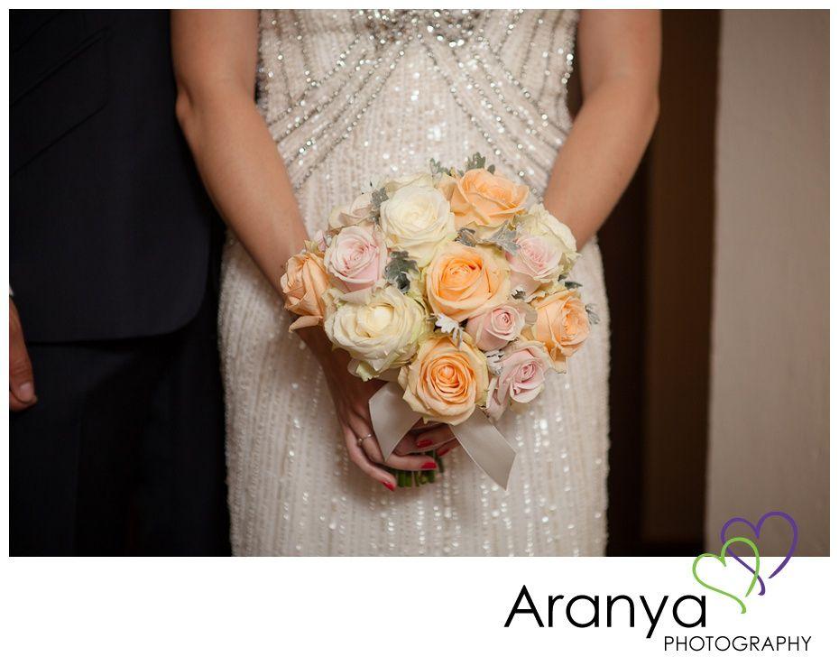 Wedding bouquet of pastel peach, pink and cream roses, shot by Kent wedding photographer, Sarah Khamsoda, of Aranya Photography at Leeds Castle http://www.aranyaphotography.co.uk/