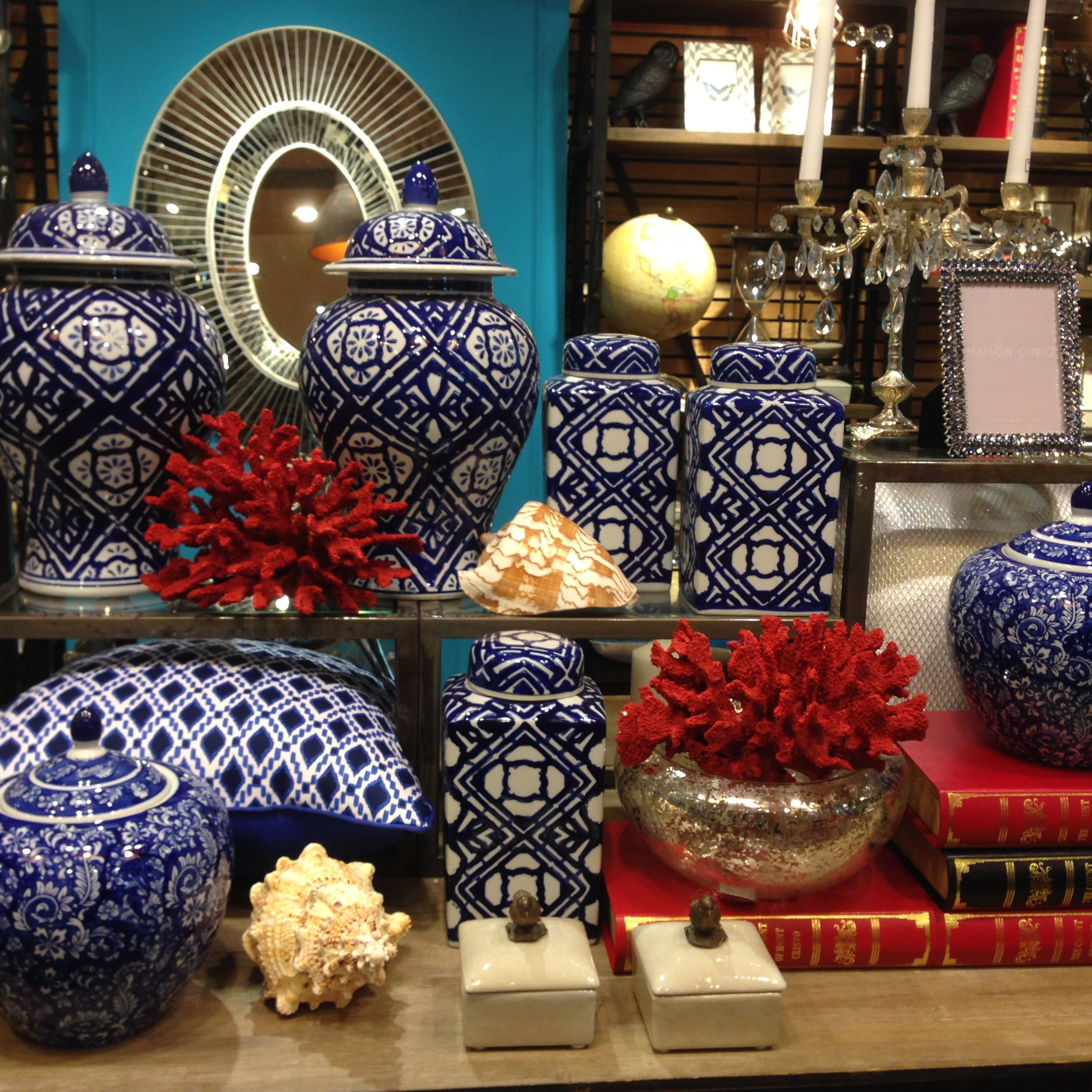A Pop Of Red Coral Brings A Vignette Of Blue
