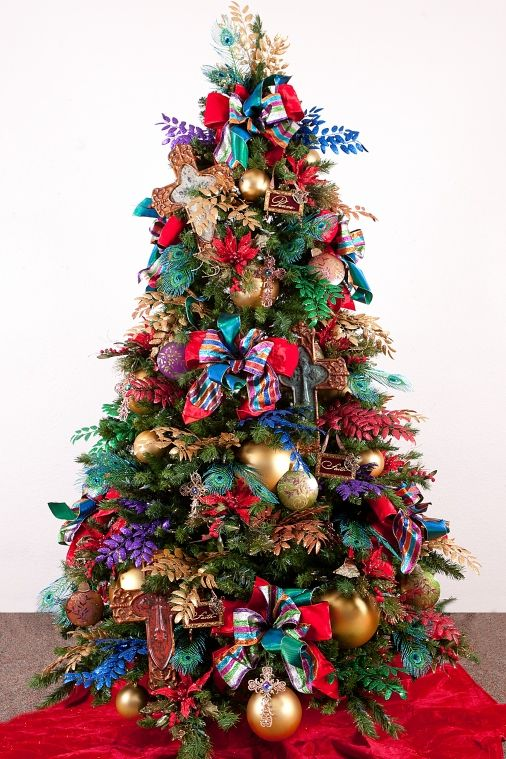 Christmas Trees-Gold Frankincense & Myrrh-Royal Jewel Tones fit for our King! Your holiday tree will be a Joyous Celebration with gold balls, peacock touches,  copper ribbon and  your Nativity ornaments.  http://www.showmedecorating.com