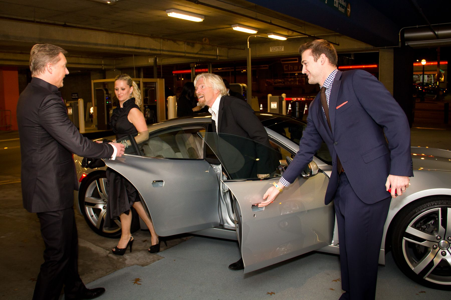 Sir Richard Branson in greeted by Henrik Fisker as he ...