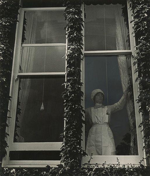 "BILL BRANDT, Maid at Window, Mayfair, 1936, silver print, printed ca. 1950s, 9"" x 7 3/4"""