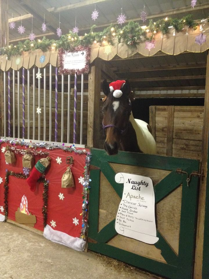 my horses christmas stall for our stall decorating contest in 2012 naughty list with bags of coal hanging over the fireplace and in his stocking
