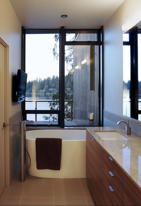 Images Of Narrow bathroom with a small tub placed near the windows
