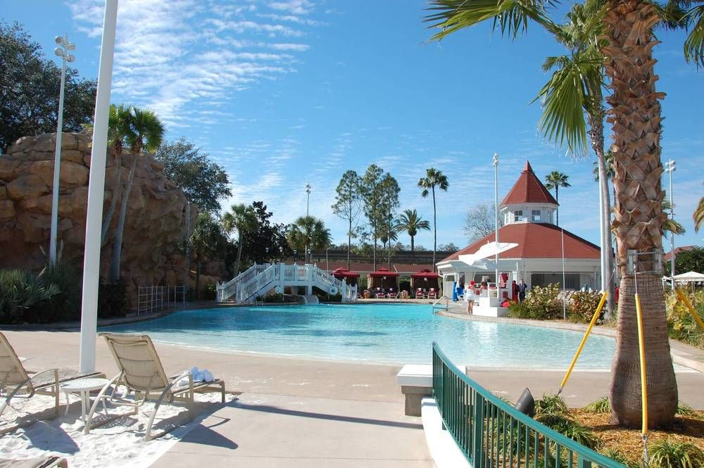 The Beach Pool At Disney S Grand Florida Resort Has A Waterslide Cabanas And Zero Entry