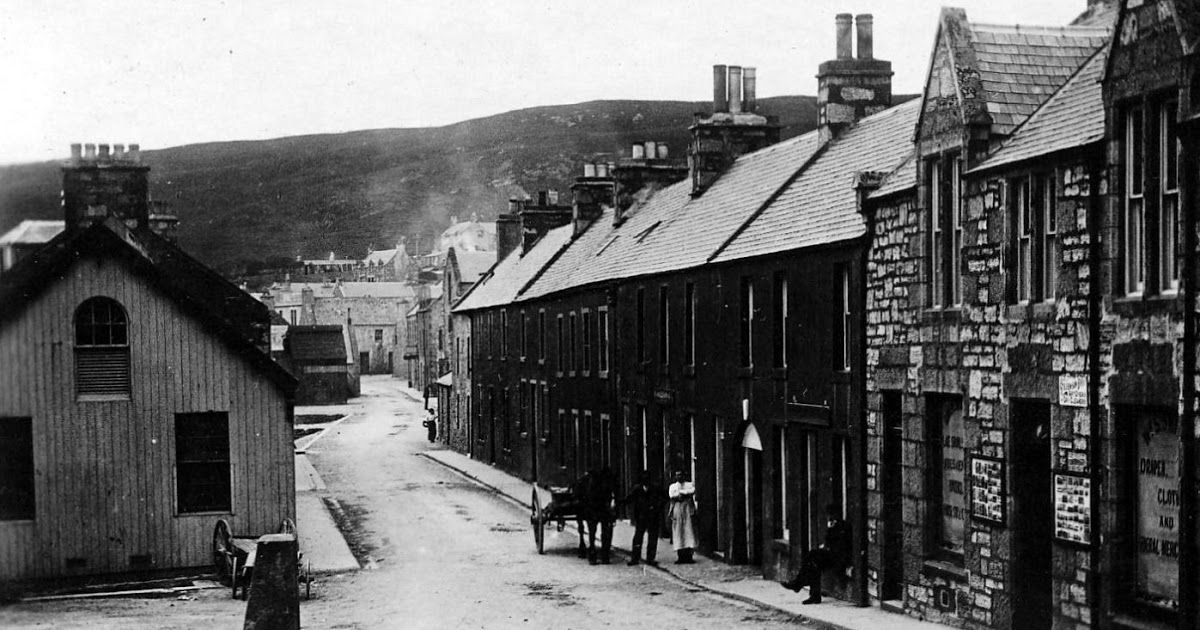 Old photograph of a shop, people and houses on Mid Shore Street in Scalloway on the Shetland Islands , Scotland . Blog post of interest to f... #shetlandislands