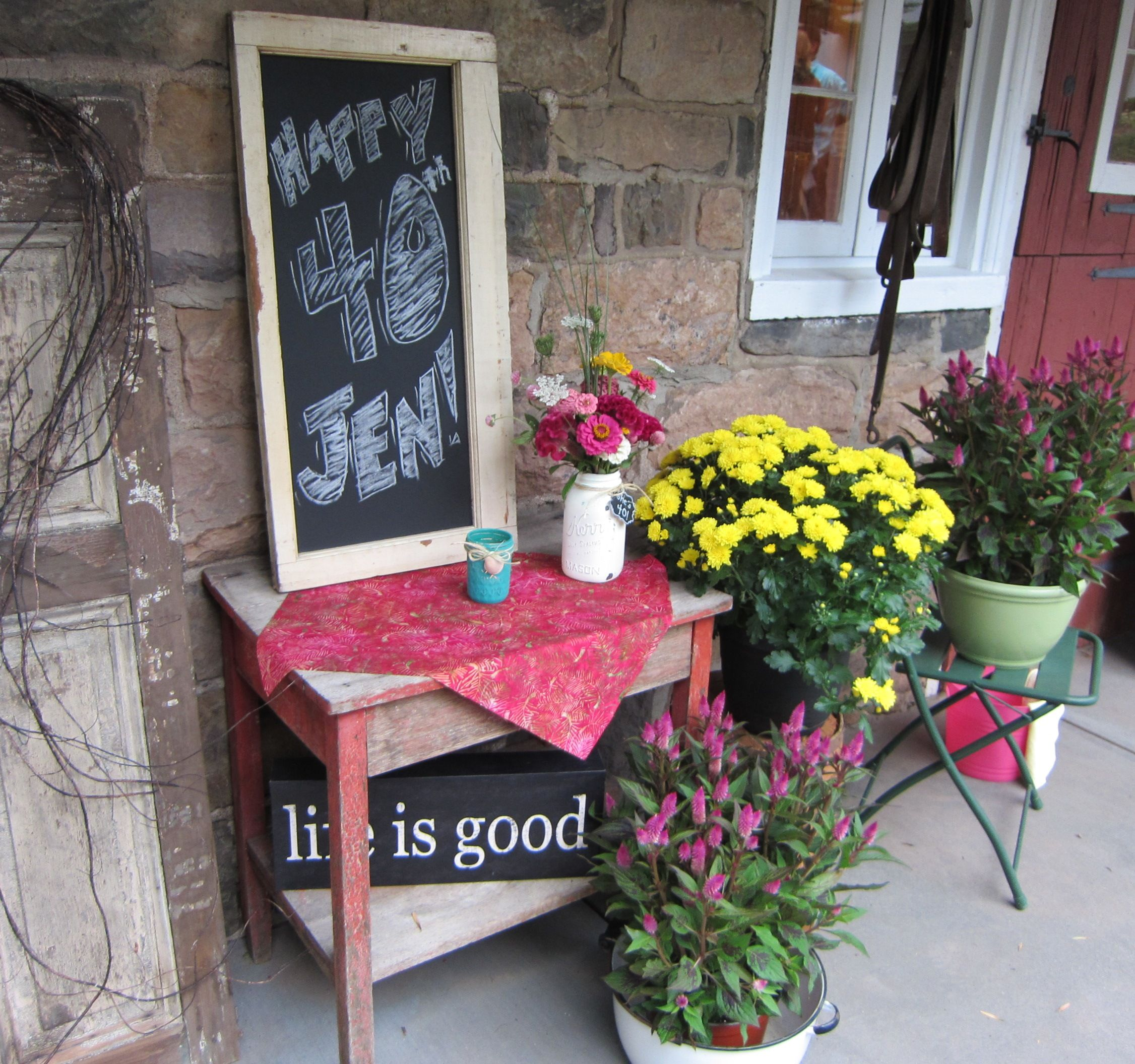 At the barn entrance we had a welcome table with a chalkboard, flowers in a chalk-paint mason jar, and mums.