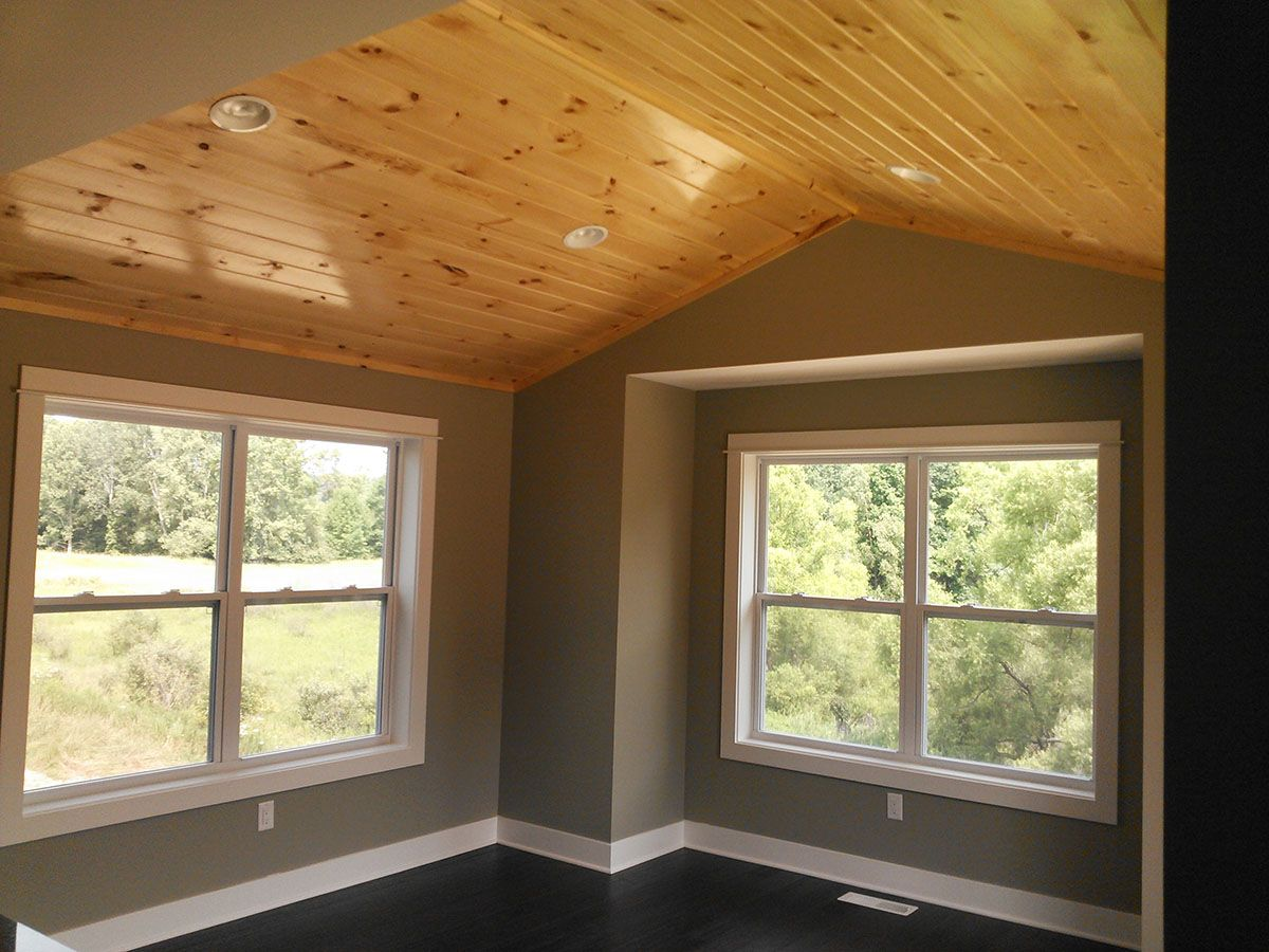 Dining room with knotty pine ceiling built by armstrong builders of rockford mi