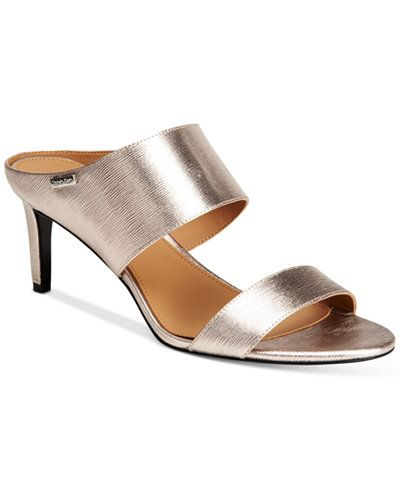 99a5a02068a Calvin Klein s Cecily sandals have a slide silhouette that keeps them easy  to wear while leather keeps the look sophisticated enough for the office  and out ...