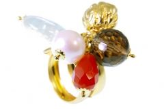 Add some color and fun with this beaded ring by Rajola. Made in 14K gold plated sterling silver, the wrap-around band is completely adjustable. Attached at the center is a cluster of beading - a white pearl, a round smokey topaz gemstone, a red cornaline tear-drop, a soft green quartz gemstone and a gold plated nugget. Get it today at TreborStyle.com
