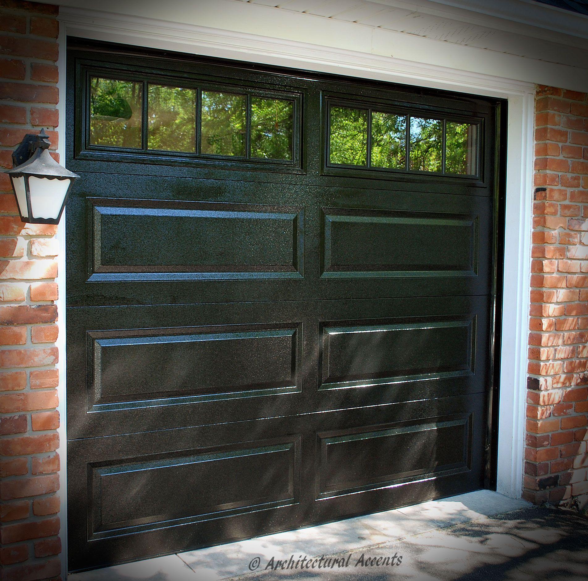 Single Black Garage Door White Aluminum Capping On The Frame