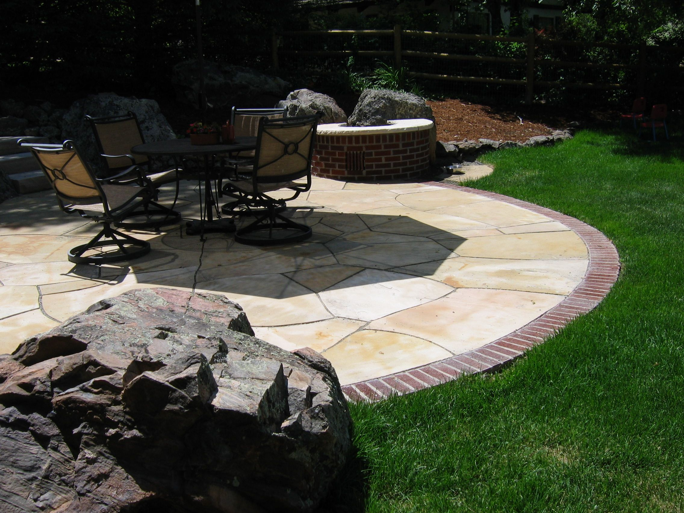 Buff Flagstone Patio With Brick Edge And Natural Boulders. By Native Edge  Landscapes In Boulder