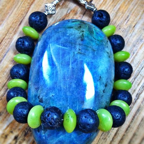 Forged in fire from deep within the Earth, Lava stone deepens the wearer's connection to decision making, strength, and protection through its association with the root chakra.  Frequently found in stream beds and along rocky lake shores, Jade's vibrant greens connect to an ancient association with health, abundance, and balance. These very attributes will be opened for the wearer of this bracelet, as jade has a powerful connection with the  Heart chakra.