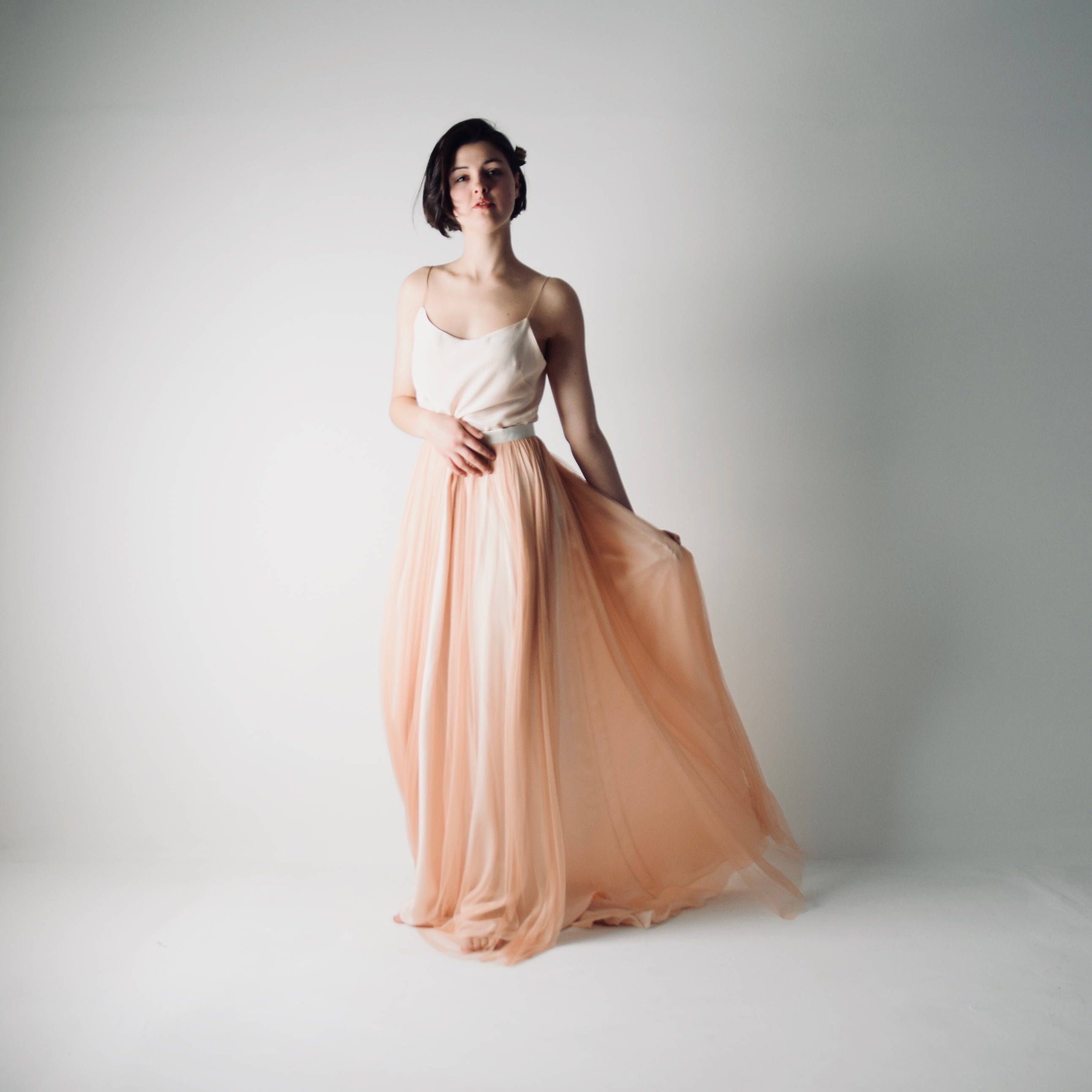 f4ccf66aa765 The Abelia Blush wedding dress separates, made of a tulle and silk skirt  and top. Relaxed but sophisticated. This wedding dress outfit features two  pieces, ...