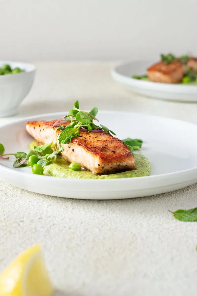 Salmon and peas are a classic combination. I brought things up a notch with seared salmon and an addictive pea puree. #searedsalmonrecipes Salmon and peas are a classic combination. I brought things up a notch with seared salmon and an addictive pea puree. #searedsalmonrecipes